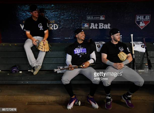 From left to right Colorado Rockies second baseman DJ LeMahieu Colorado Rockies right fielder Carlos Gonzalez and Colorado Rockies shortstop Trevor...