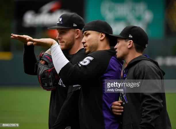 From left to right Colorado Rockies shortstop Trevor Story Colorado Rockies right fielder Carlos Gonzalez and Colorado Rockies catcher Tony Wolters...