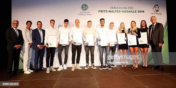 from left to right DFB national coach Steffi Jones DFB sports director Hansi Flick GianLuca Itter of Wolfsburg Kai Havertz of Leverkusen Arne Maier...