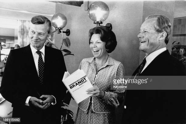 From left to right Dutch politician Jan de Koning the Minister for Development Cooperation Queen Beatrix of the Netherlands and German statesman...