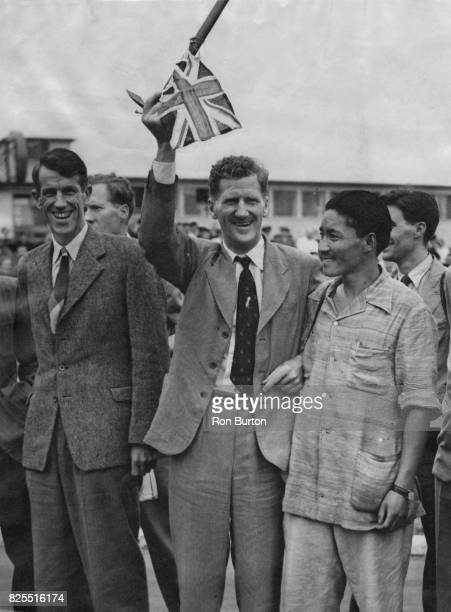 From left to right Edmund Hillary John Hunt and Sherpa Tenzing Norgay arrive at London Airport after their successful expedition to scale Mount...