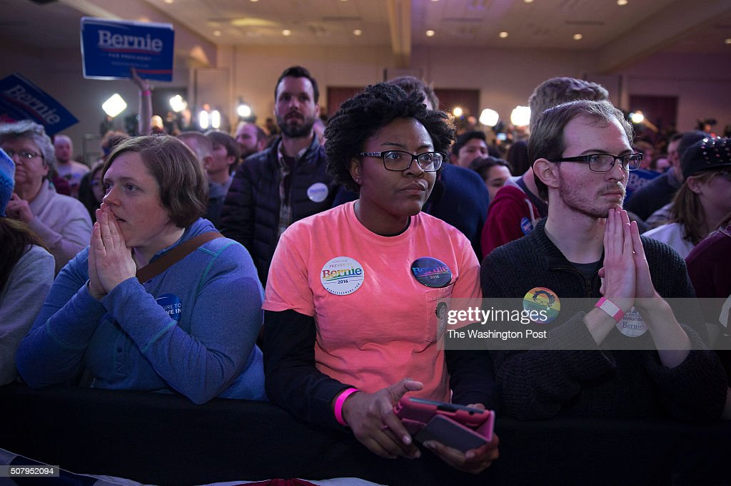 From left to right Elizabeth Buchanan, Desirrae(cq) Jones, Andrew Bryant anxious watch the close race between Sanders and Clinton as they wait for Bernie to come out