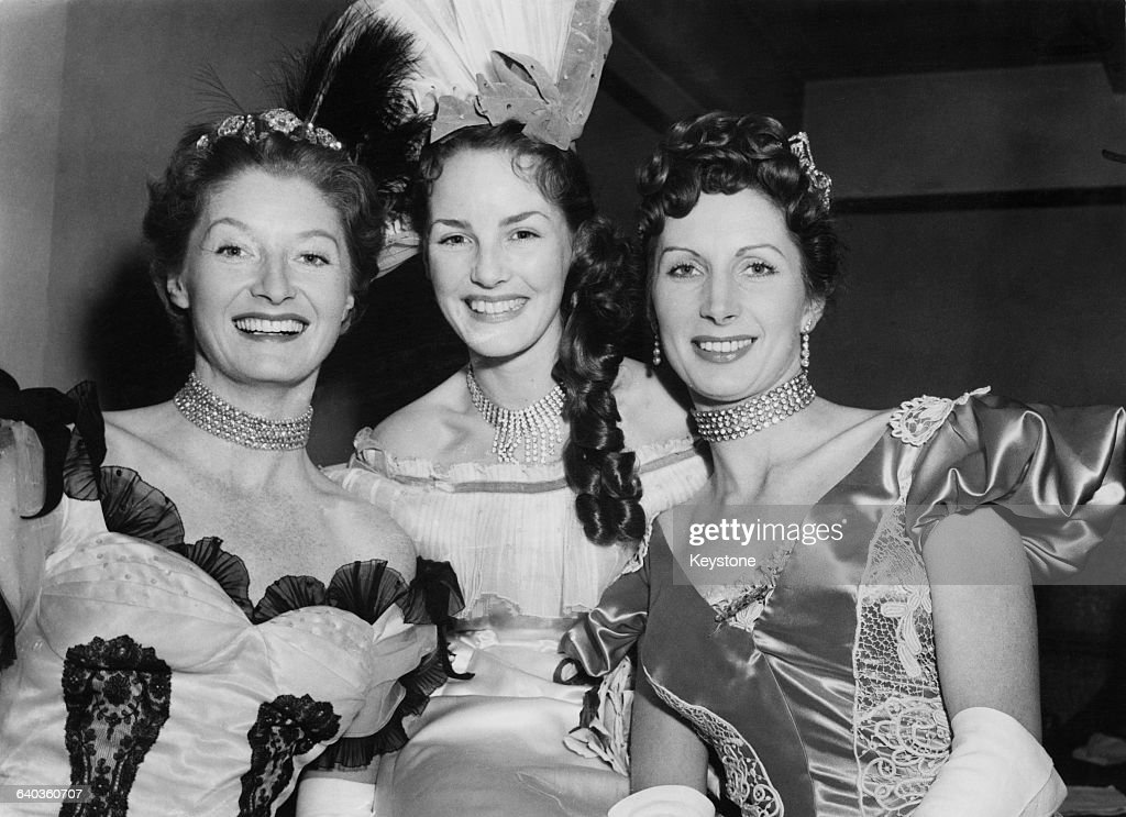 From left to right, English actresses Helen Cherry (1915 - 2001), <a gi-track='captionPersonalityLinkClicked' href=/galleries/search?phrase=Petula+Clark&family=editorial&specificpeople=208081 ng-click='$event.stopPropagation()'>Petula Clark</a> and Patricia Laffan during a dress rehearsal for a stage show which will follow the Royal Film Performance at the Empire Theatre, Leicester Square, London, 25th October 1952.