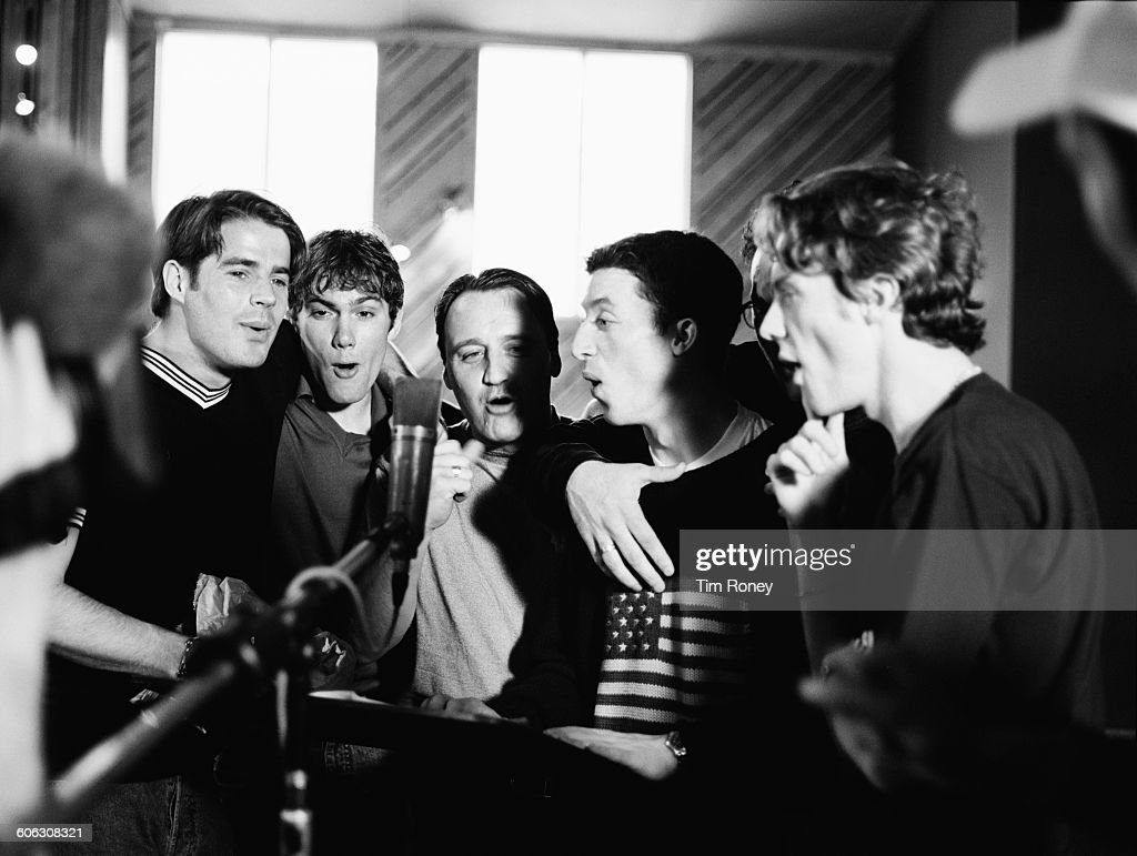 From left to right English footballers Jamie Redknapp Jason McAteer unknown Robbie Fowler and Steve McManaman of Liverpool FC in a recording studio...