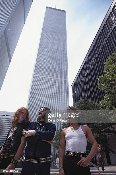 From left to right Fast Eddie Clarke Lemmy and Phil 'Philthy Animal' Taylor of English rock band Motorhead at the foot of the World Trade Centre in...