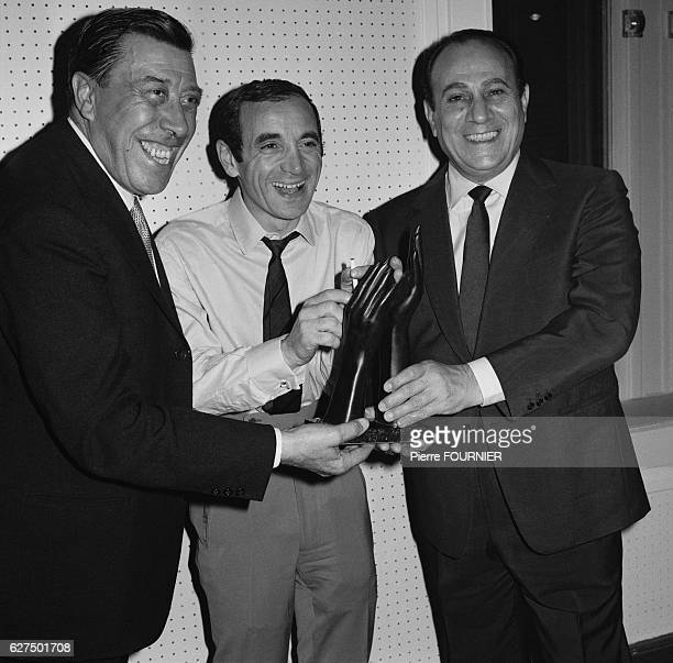 Fernandel Tino Rossi and Charles Aznavour at the 'Bravos du Music Hall' award ceremony
