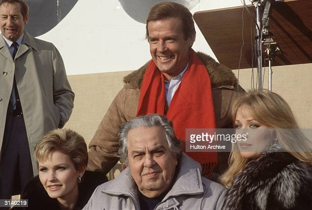 From left to right Fiona Fullerton producer Albert 'Cubby' Broccoli and Tanya Roberts and behind them a grinning Roger Moore during the making of the...