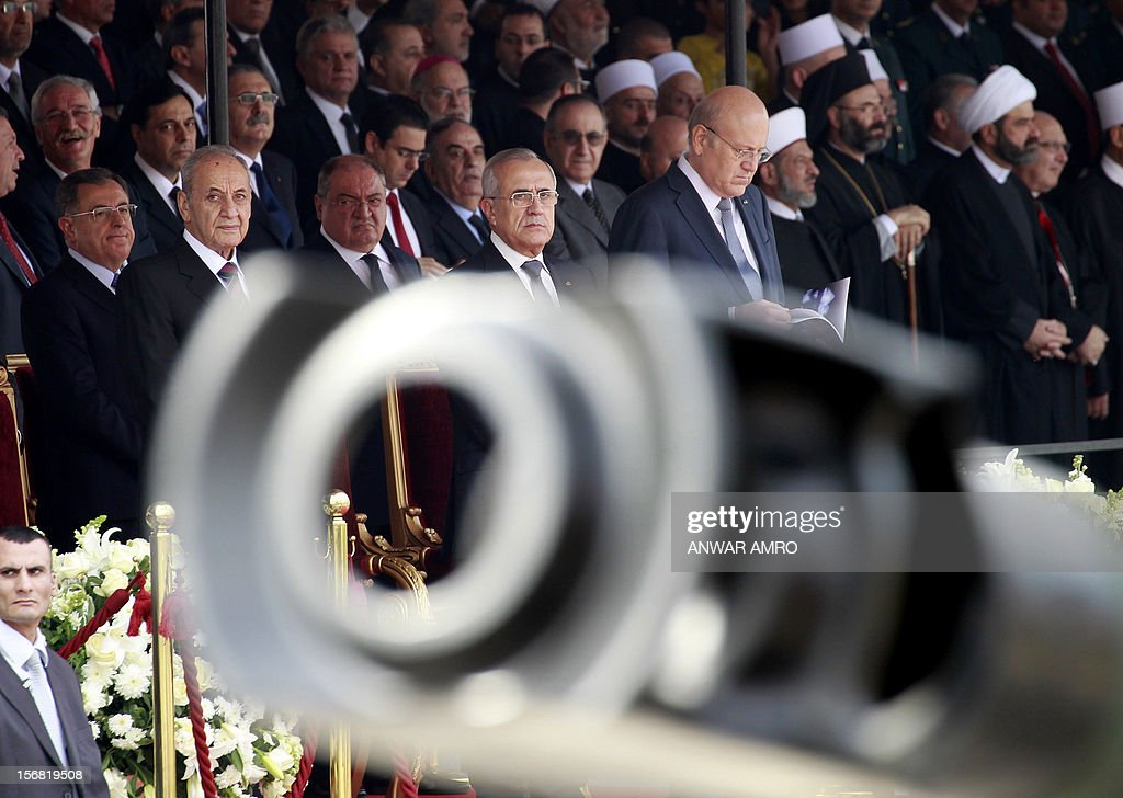 Former Lebanese prime minister Fuad Siniora, Parliament Speaker Nabih Berri, President Michel Sleiman and current Prime Minister Najib Mikati attend a military parade marking Lebanon's 69th Indepen...