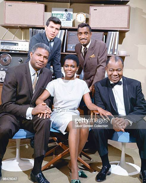 From left to right Mel Torme and Sammy Davis Jr Ossie Davis Cicely Tyson and Louis Armstrong the stars of the film 'A Man Called Adam' 1966