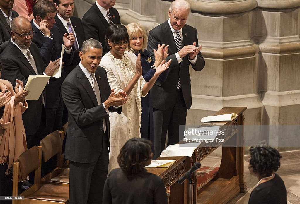 JANUARY 22 -- From left to right front row, President Barack Obama, First Lady Michelle Obama, Dr. Jill Biden and Vice-President Joe Biden applaud members of the Washington Performing Arts Society of the Gospel Choir during the 57th Presidential Inaugural Prayer Service at the Washington National Cathedral in Washington, D.C., on Tuesday, January 22, 2013.