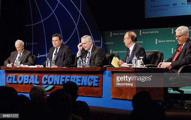 From left to right Gary Becker Nobel Laureate of Economic Sciences Guy Laffineur head of debt capital markets Calyon Paul Gigot session moderator and...