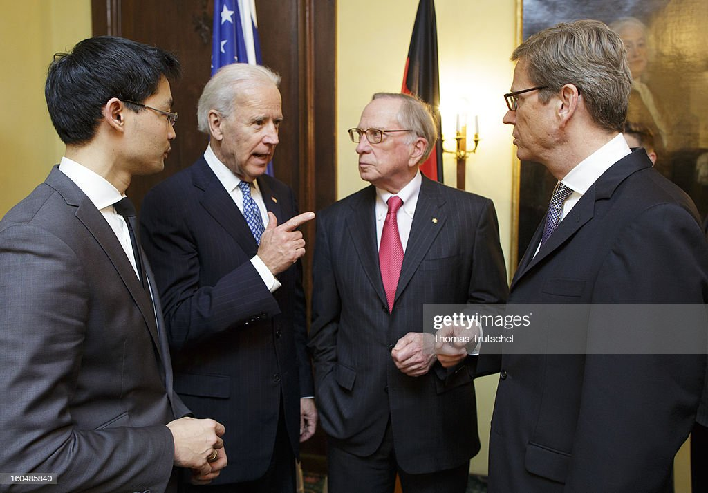 German Economy Minister and Vice Chancellor Philipp Roesler, U.S. Vice President Joe Biden, U.S. Senator <a gi-track='captionPersonalityLinkClicked' href=/galleries/search?phrase=Sam+Nunn&family=editorial&specificpeople=209203 ng-click='$event.stopPropagation()'>Sam Nunn</a>, and German Foreign Minister <a gi-track='captionPersonalityLinkClicked' href=/galleries/search?phrase=Guido+Westerwelle&family=editorial&specificpeople=208748 ng-click='$event.stopPropagation()'>Guido Westerwelle</a> talking during the Reception on the occasion of the award of the large Bundesverdienstkreuz with Star of the Federal Republic of Germany to U.S. Senator <a gi-track='captionPersonalityLinkClicked' href=/galleries/search?phrase=Sam+Nunn&family=editorial&specificpeople=209203 ng-click='$event.stopPropagation()'>Sam Nunn</a> on day 1 of the 49th Munich Security Conference at Hotel Bayerischer Hof on February 1, 2013 in Munich, Germany. The Munich Security Conference brings together senior figures from around the world to engage in an intensive debate on current and future security challenges and remains the most important independent forum for the exchange of views by international security policy decision-makers.