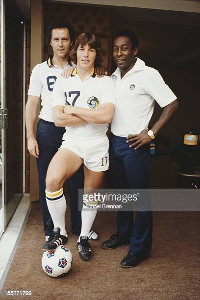 From left to right German footballer Franz Beckenbauer American soccer midfielder Rick Davis and Brazilian footballer Pele in Uberlândia Brazil June...