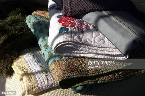 green 'grass' throw by Andrew Morgan $449 from Bedfellows Green and white ticking striipe queen–size cotton blanket $225 from Scandia Down Yellow...