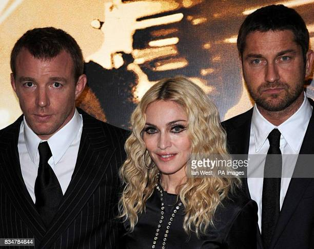 From left to right Guy Ritchie Madonna and Gerard Butler attends the UK Premiere of Guy Ritchies latest film RocknRolla Leicester Square in central...