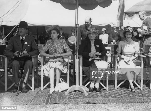 From left to right Henry Somerset the 10th Duke of Beaufort Princess Elizabeth the Duchess of Beaufort and Princess Margaret attend the first day of...
