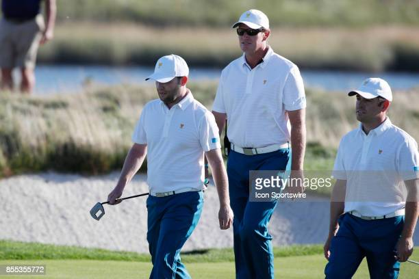 From left to right International golfer Branden Grace vice captain Ernie Els and golfer Louis Oosthuizen who are all from South Africa walk the 14th...