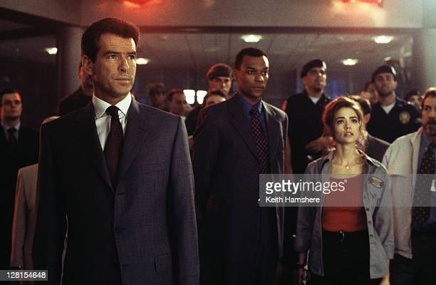From left to right Irish actor Pierce Brosnan as 007 English actor Colin Salmon as Charles Robinson and American actress Denise Richards as Dr...