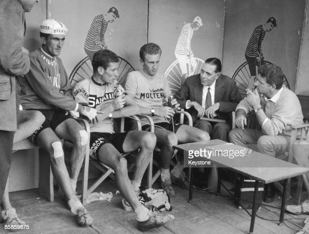 From left to right Italian competitors Franco Bitossi Felice Gimondi and Gianni Motta and interviewed by journalists Luigi Chierici and Sergio Zavoli...