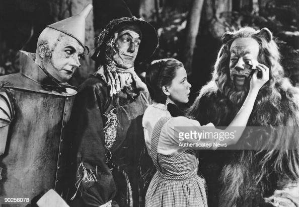 From left to right Jack Haley as the Tin Man Ray Bolger as the Scarecrow Judy Garland as Dorothy and Bert Lahr as the Cowardly Lion in the MGM film...