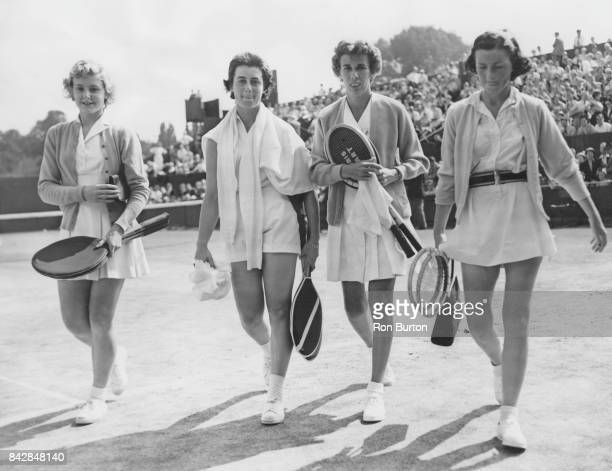 From left to right Jennifer Middleton Doreen Spiers Doris Hart and Barbara Davidson leave the court after the Women's Doubles at Wimbledon London...