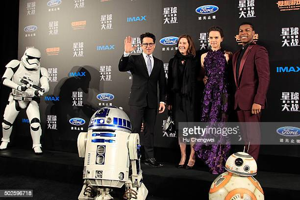 From left to right JJ Abrams Kathleen Kennedy Daisy Ridley John Boyega attend the premiere of Star Wars on December 27 2015 in Shanghai China