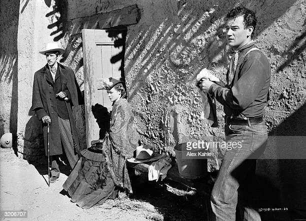 From left to right John Carradine Claire Trevor and John Wayne star in the western 'Stagecoach' directed by John Ford