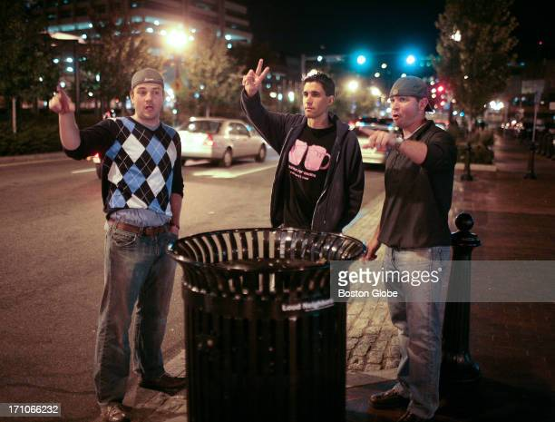 From left to right John Fears Dylan McKay and Patrick Hall try to call a cab on Cross Street after a night of bar hopping early Sunday morning in the...