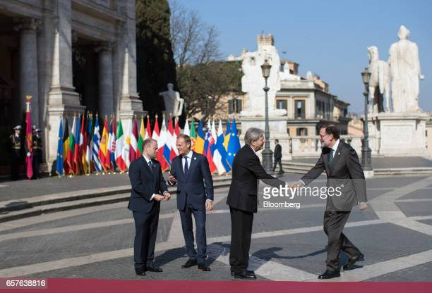 Joseph Muscat Malta's prime minister and Donald Tusk president of the European Union look on as Paolo Gentiloni Italy's prime minister greets Mariano...