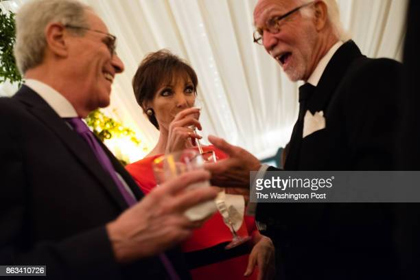 From left to right Judge Paul L Friedman his wife Elizabeth Friedman and AR Esfandiary sip cocktails and talk Every year Calvin and Jane Cafritz have...