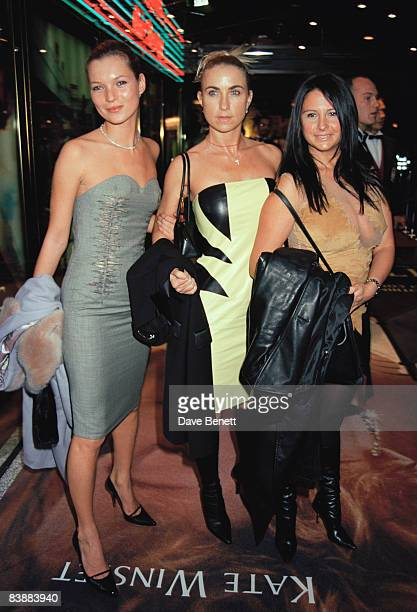 From left to right Kate Moss Meg Mathews and Fran Cutler attend the London premiere of 'Titanic' at the Empire Leicester Square 18th November 1997