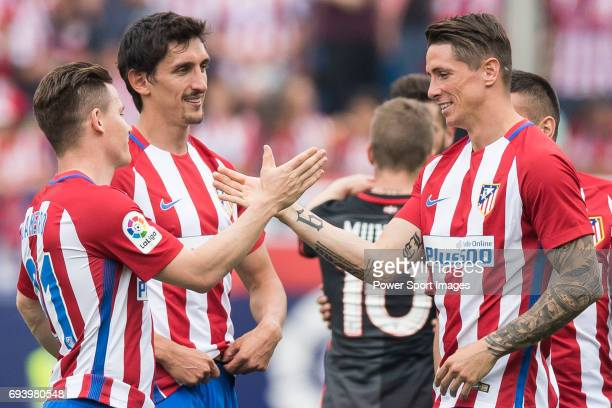From Left to Right Kevin Gameiro Stefan Savic and Fernando Torres of Atletico de Madrid celebrate their win after their La Liga match between...