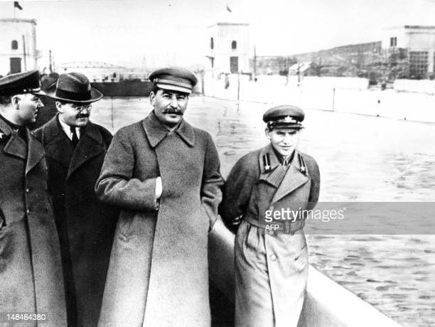 Kliment Vorochilov Vyacheslav Molotov Josef Stalin and Nikolai Iejov aka Nikolai Yezhov pose at the shore of the the Moscow Volga Canal in 1937...