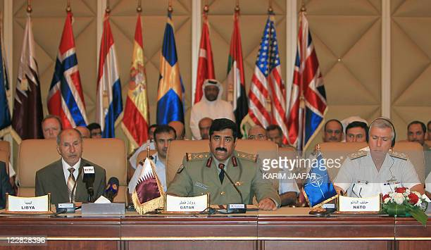 Libya's National Transitional Council chairman Mustafa Abdul Jalil Chief of Staff of Qatar's armed forces Hamad Bin Ali alAttiyah and US Admiral...