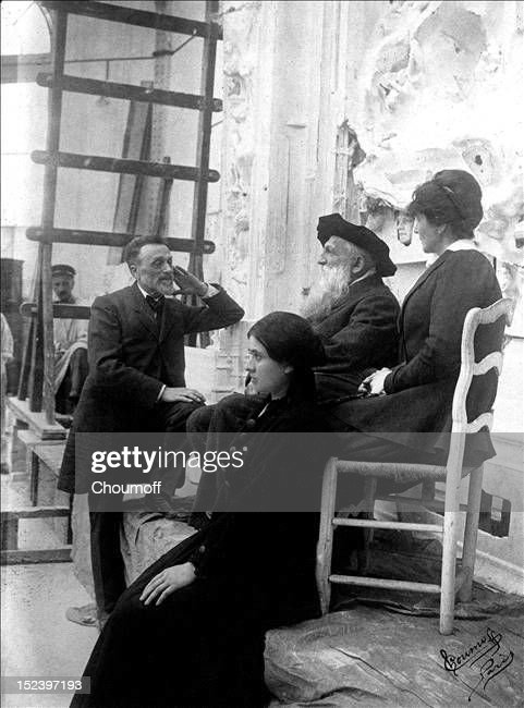 Léonce Bénédite (1856 - 1925), creator and first curator of the Rodin museum, his daughter in the foreground, French sculptor Auguste Rodin and his niece Miss Coltat, in Meudon, Paris, before 'La Porte de l'Enfer', a work by the artist, about 1915.