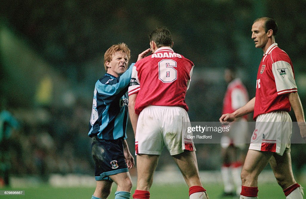 From left to right, midfielder Gordon Strachan of Coventry City, and defenders Tony Adams and Steve Bould of Arsenal, during an FA Carling Premiership match at Highfield Road in Coventry, UK, 21st April 1997. The score was 1-1.
