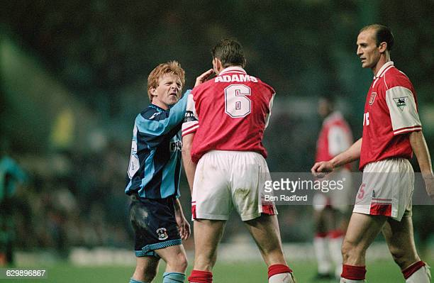 From left to right midfielder Gordon Strachan of Coventry City and defenders Tony Adams and Steve Bould of Arsenal during an FA Carling Premiership...
