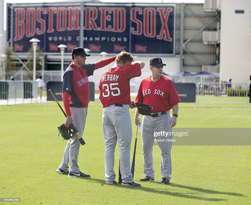 Minor League coach, Tom Kotchman, Lyle Overbay and third base coach, Brian Butterfield during the first official spring training day for the Boston Red Sox pitchers and catchers at JetBlue Park on Tuesday, Feb. 12, 2013.