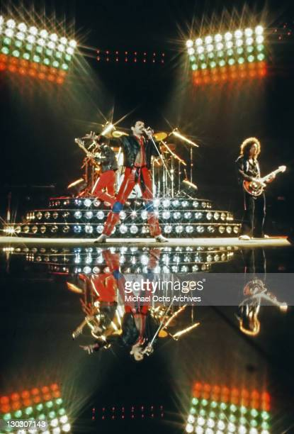 From left to right musician John Deacon Freddie Mercury and Brian May of British rock band Queen during a concert at the Groenoordhallen in Leiden...