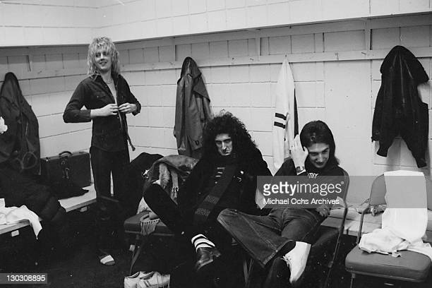 From left to right musicians Roger Taylor Brian May and John Deacon of British rock band Queen in a changing room circa 1977