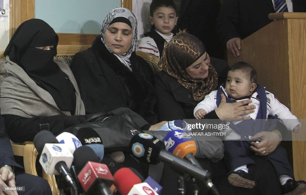 Palestinians Salam Nazal, the wife of Ali Nazal, Rima al-Selawi, the wife Osama al-Selawi and Dalal al-Zaban, the wife of Aamar al-Zaban, hold a press conference in the northern West Bank city of Nablus on February 6, 2013, to announce they have received a transfer of sperm from their husbands being held in Israeli Jails. On August 13, 2012, Dala the wife of Palestinian prisoner Amer al-Zein gave birth to a son following a sperm transfer from her husband serving a life sentence in an Israeli prison. AFP PHOTO/JAAFAR ASHTIYEH