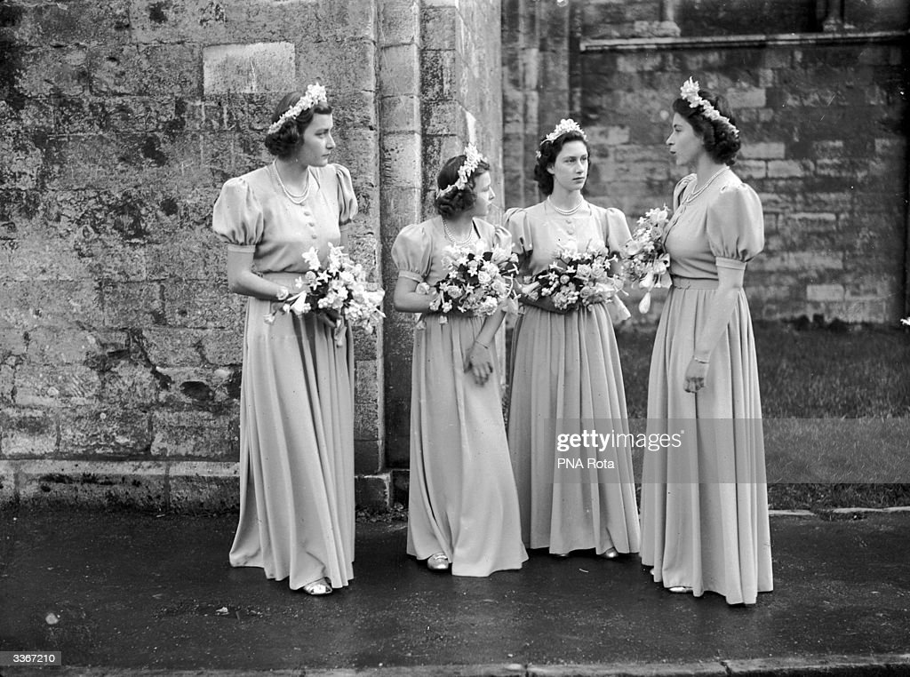 From left to right, Pamela Mountbatten, Princess Alexandra of Kent, Princess Margaret (1930 - 2002) and Princess Elizabeth stand outside Romsey Abbey, Hampshire in their bridesmaids' dresses after attending the wedding of Captain Lord Brabourne and Patricia Mountbatten.
