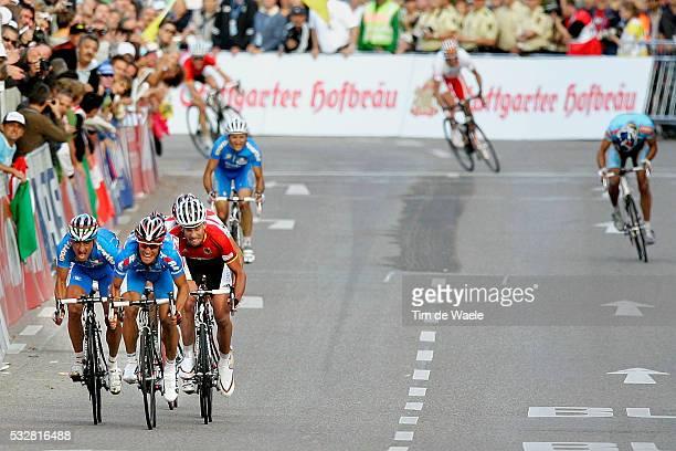 Paolo Bettini Alexandr Kolobnev and Stefan Schumacher finish the 2007 Men's UCI World Championships