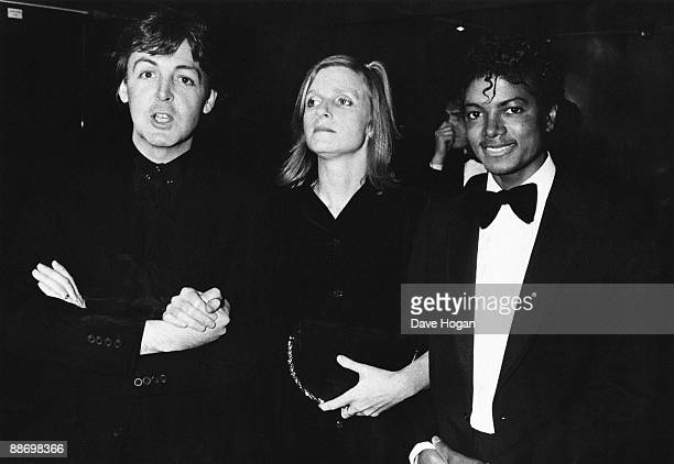 From left to right Paul McCartney poses with his wife Linda and Michael Jackson at the British Record Industry Awards in London 16th February 1983...