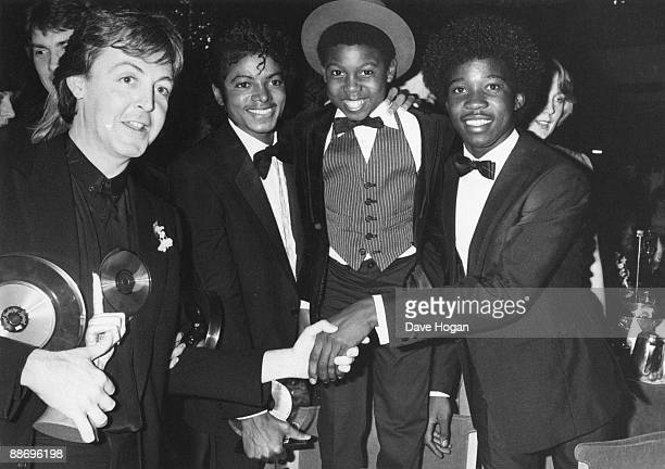 From left to right Paul McCartney poses with Michael Jackson and Michael Grant and Junior Waite of Musical Youth at the British Record Industry...