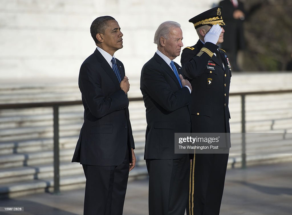 from left to right President Barack Obama and Vice President Joe Biden with Major General Michael Linnington attend a wreath laying at the Tomb of the Unknowns at Arlington National Cemetery in Arlington, Virginia on January 20, 2013.
