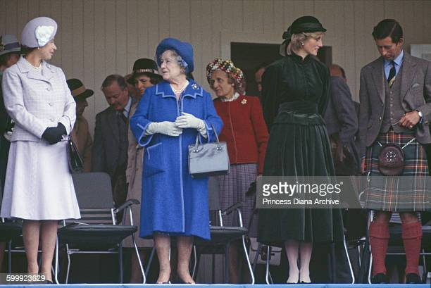 From left to right Queen Elizabeth II the Queen Mother Diana Princess of Wales and Prince Charles at the Braemar Highland Games Gathering in Scotland...