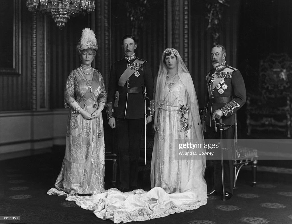 From left to right; Queen Mary, King George V, with their daughter Victoria Alexandra Alice Mary, the Princess Royal, and Viscount Lascelle, 6th Earl of Harewood, on their wedding day.