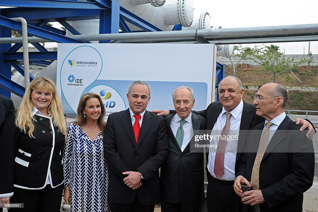 Ravit Barniv, chairman of Shikun & Binui, Shari Arison, owner of the Arison Group, Yuval Steinitz, Israel's finance minister, Shimon Peres, Israel's president, Yitzhak Tshuva, head of Delek Group, and Haim Landau, Israel's minister of national infrastructures, pose at the opening event of a new desalination facility in Hadera, Israel, on Sunday, May 16, 2010. Israeli companies have 'endless' possibilities to sell clean technology to China in areas such as water recycling, desalination and solar power, Environmental Protection Minister Gilad Erdan said. Photographer: Ahikam Seri/Bloomberg via Getty Images