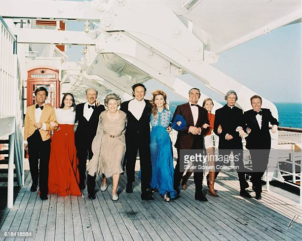 From left to right Roddy McDowall Pamela Sue Martin Jack Albertson Shelley Winters Gene Hackman Stella Stevens Ernest Borgnine Carol Lynley Arthur...